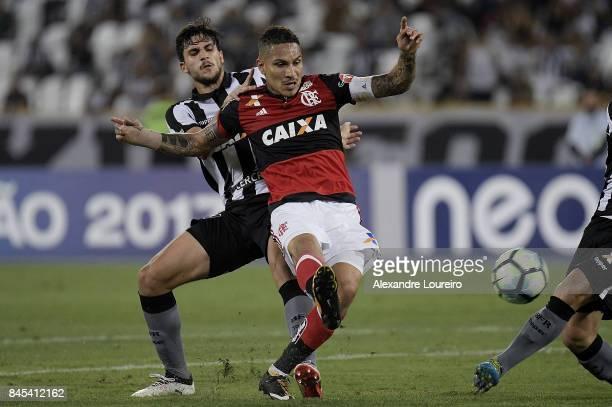 Igor Rabello of Botafogo battles for the ball with Guerrero of Flamengo during the match between Botafogo and Flamengo as part of Brasileirao Series...