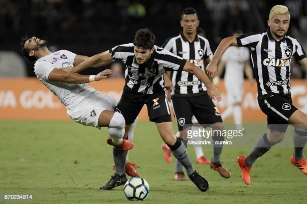 Igor Rabello of Botafogo battles for the ball with Henrique Dourado of Fluminense during the match between Botafogo and Fluminense as part of...