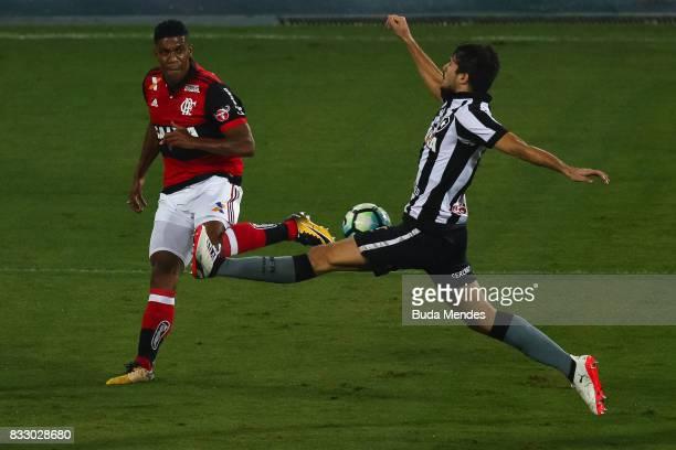 Igor Rabello of Botafogo struggles for the ball with Orlando Berro of Flamengo during a match between Botafogo and Flamengo as part of Copa do Brasil...