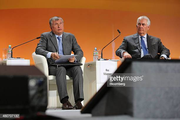 Igor Sechin chief executive officer of OAO Rosneft lef and Rex Tillerson chief executive officer of Exxon Mobil Corp pause during a plenary session...