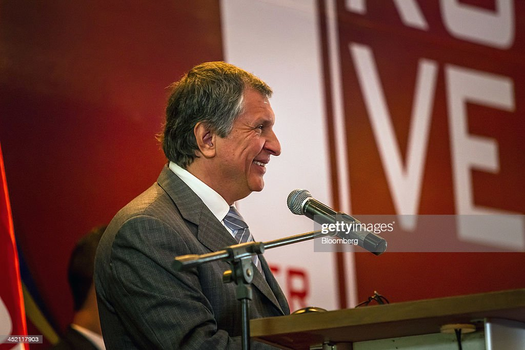 Igor Sechin, chief executive officer of OAO Rosneft, smiles during a presentation at the Russia-Venezuela Oil Congress on Margarita Island in Nueva Esparta, Venezuela, on Thursday, Nov. 21, 2013. OAO Rosneft, Russia's largest oil producer, plans to invest $13 billion in five projects in Venezuela over five years and buy at least part of OAO Lukoil's stake in a producing field in the South American nation. Photographer: Meridith Kohut/Bloomberg via Getty Images