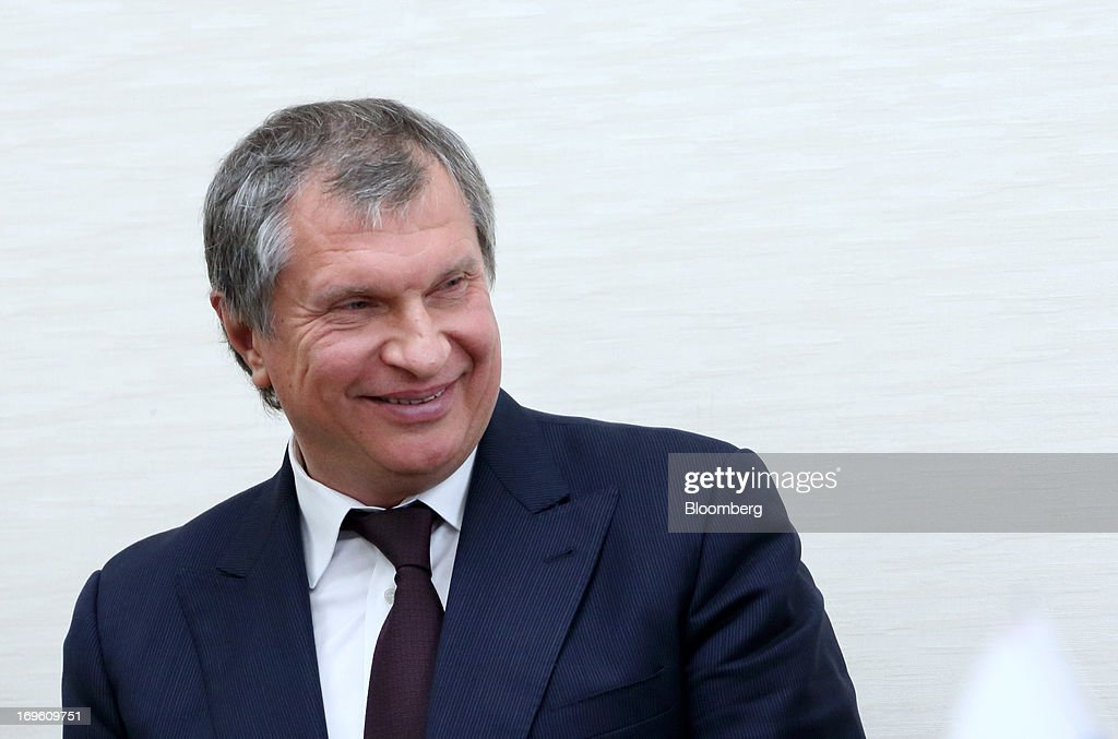 Igor Sechin, president and chairman of OAO Rosneft, smiles during a signing ceremony with Toshiaki Kitamura, president of Inpex Holdings Inc., unseen, at the Ministry of Economy, Trade and Industry in Tokyo, Japan, on Wednesday, May 29, 2013. Inpex, Japan's biggest energy explorer, and Russia's Rosneft signed a preliminary agreement to develop oil and gas blocks in the Sea of Okhotsk. Photographer: Tomohiro Ohsumi/Bloomberg via Getty Images