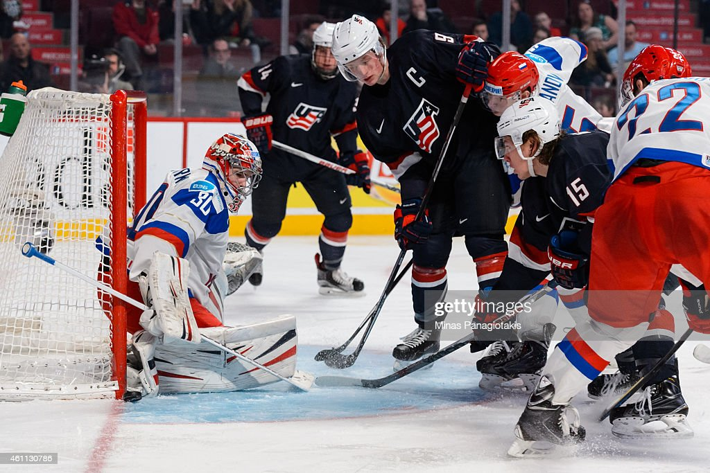 Igor Shesterkin #30 of Team Russia makes a skate save with <a gi-track='captionPersonalityLinkClicked' href=/galleries/search?phrase=Jack+Eichel&family=editorial&specificpeople=13623111 ng-click='$event.stopPropagation()'>Jack Eichel</a> #9 of Team United States and teammate <a gi-track='captionPersonalityLinkClicked' href=/galleries/search?phrase=John+Hayden+-+Ice+Hockey+Player&family=editorial&specificpeople=15212509 ng-click='$event.stopPropagation()'>John Hayden</a> #15 ready for the rebound in a quarterfinal round during the 2015 IIHF World Junior Hockey Championships at the Bell Centre on January 2, 2015 in Montreal, Quebec, Canada. Team Russia defeated Team United States 3-2.