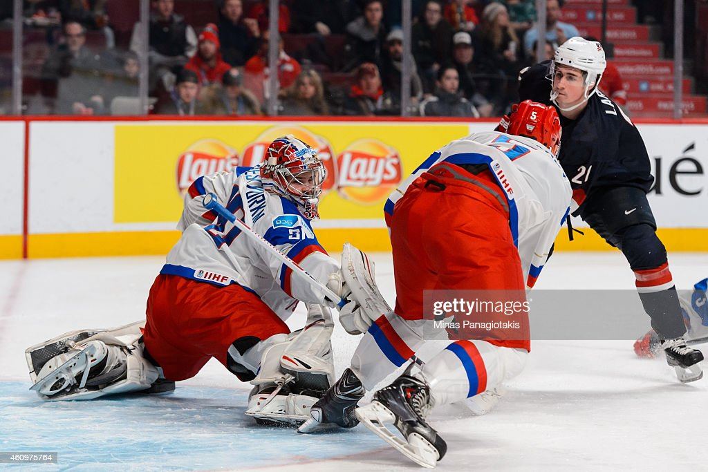 Igor Shesterkin #30 of Team Russia stretches out the pad and blocker to make a save on Dylan Larkin #21 of Team United States in a quarterfinal round during the 2015 IIHF World Junior Hockey Championships at the Bell Centre on January 2, 2015 in Montreal, Quebec, Canada.