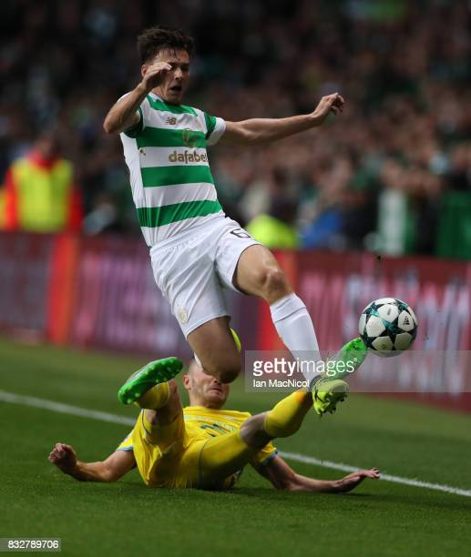 Igor Shitov of FC Astana vies with Kieran Tierney of Celtic during the UEFA Champions League Qualifying PlayOffs Round First Leg match between Celtic...