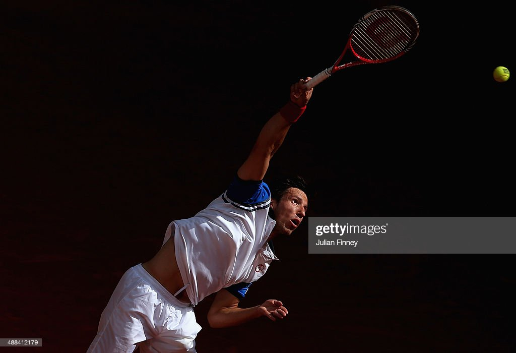 Igor Sijsling of Holland serves to Tommy Haas of Germany during day four of the Mutua Madrid Open tennis tournament at the Caja Magica on May 6, 2014 in Madrid, Spain.