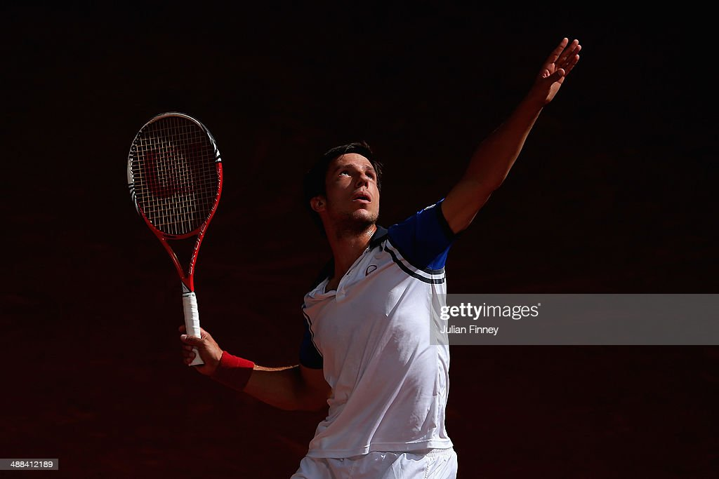 <a gi-track='captionPersonalityLinkClicked' href=/galleries/search?phrase=Igor+Sijsling&family=editorial&specificpeople=878881 ng-click='$event.stopPropagation()'>Igor Sijsling</a> of Holland serves to Tommy Haas of Germany during day four of the Mutua Madrid Open tennis tournament at the Caja Magica on May 6, 2014 in Madrid, Spain.