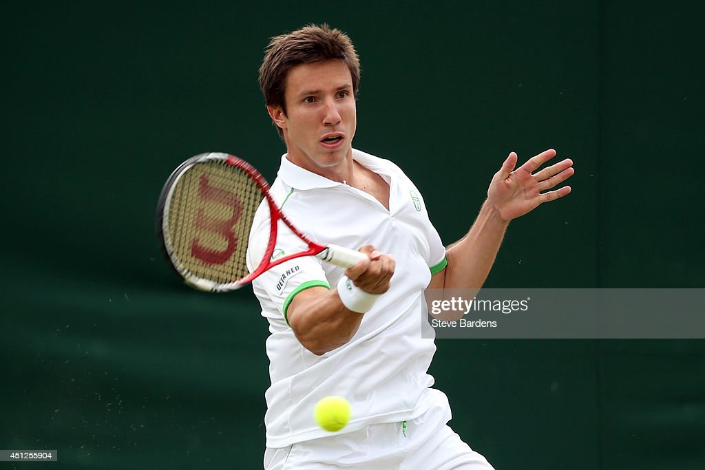 <a gi-track='captionPersonalityLinkClicked' href=/galleries/search?phrase=Igor+Sijsling&family=editorial&specificpeople=878881 ng-click='$event.stopPropagation()'>Igor Sijsling</a> of Netherlands during his Gentlemen's Doubles first round match with Roberto Bautista Agut of Spain against Sergiy Stakhovsky of Ukraine and Kyle Edmund of Great Britain and on day four of the Wimbledon Lawn Tennis Championships at the All England Lawn Tennis and Croquet Club at Wimbledon on June 26, 2014 in London, England.