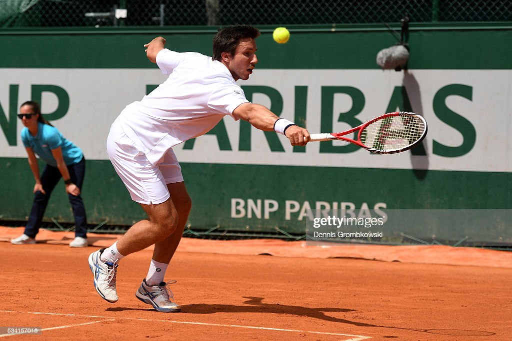 <a gi-track='captionPersonalityLinkClicked' href=/galleries/search?phrase=Igor+Sijsling&family=editorial&specificpeople=878881 ng-click='$event.stopPropagation()'>Igor Sijsling</a> of Netherlands hits a backhand during the Men's Singles second round match against Nick Kyrgios of Australia on day four of the 2016 French Open at Roland Garros on May 25, 2016 in Paris, France.