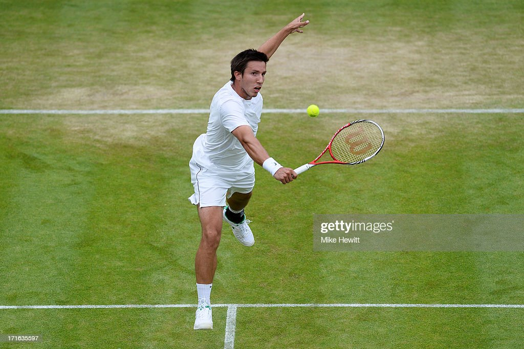 <a gi-track='captionPersonalityLinkClicked' href=/galleries/search?phrase=Igor+Sijsling&family=editorial&specificpeople=878881 ng-click='$event.stopPropagation()'>Igor Sijsling</a> of Netherlands plays a backhand during his Gentlemen's Singles second round match against Milos Raonic of Canada on day four of the Wimbledon Lawn Tennis Championships at the All England Lawn Tennis and Croquet Club on June 27, 2013 in London, England.