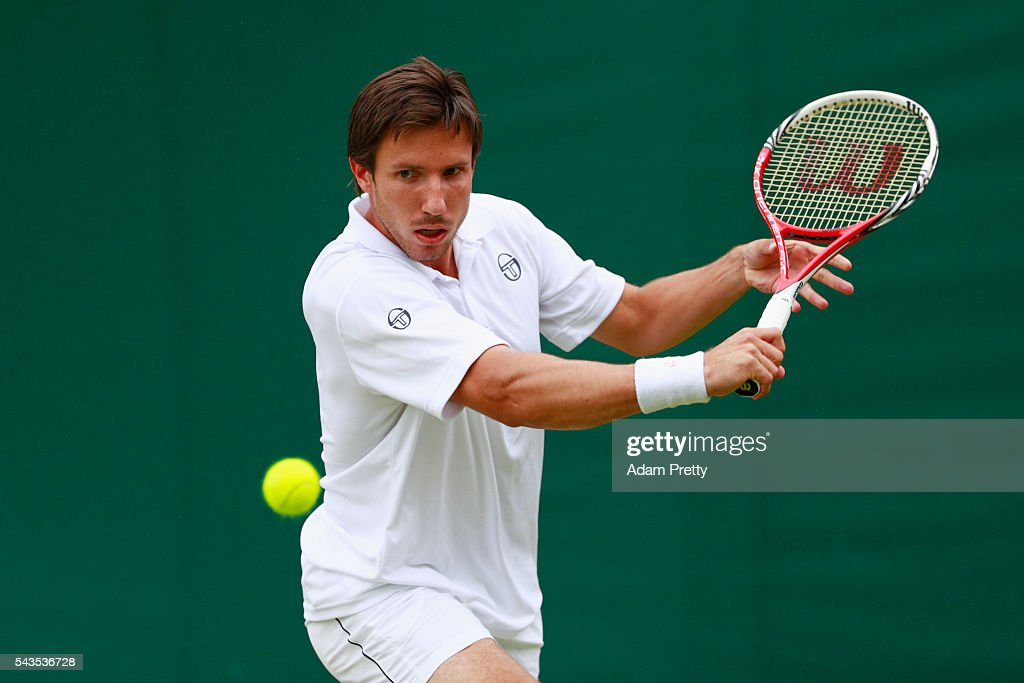 <a gi-track='captionPersonalityLinkClicked' href=/galleries/search?phrase=Igor+Sijsling&family=editorial&specificpeople=878881 ng-click='$event.stopPropagation()'>Igor Sijsling</a> of Netherlands plays a backhand during the Men's Singles first round match against Jiri Vesely of Czech Republic on day three of the Wimbledon Lawn Tennis Championships at the All England Lawn Tennis and Croquet Club on June 29, 2016 in London, England.