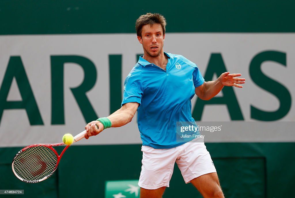 Igor Sijsling of Netherlands plays a forehand in his Men's Singles match against Ernests Gulbis of Latvia on day one of the 2015 French Open at Roland Garros on May 24, 2015 in Paris, France.