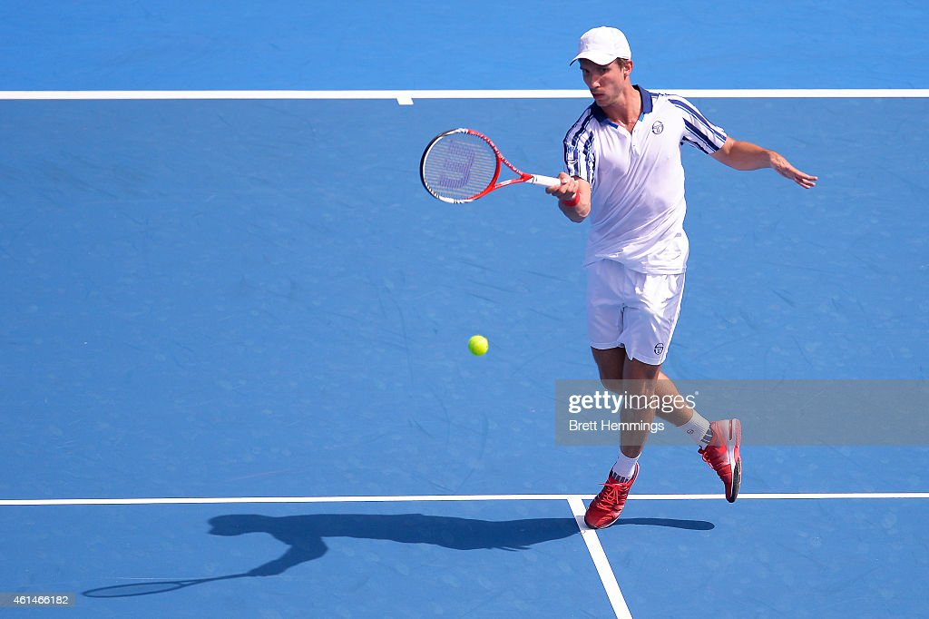 Igor Sijsling of Netherlands plays a forehand shot in his first round match against Bernard Tomic of Australia during day three of the Sydney International at Sydney Olympic Park Tennis Centre on January 13, 2015 in Sydney, Australia.