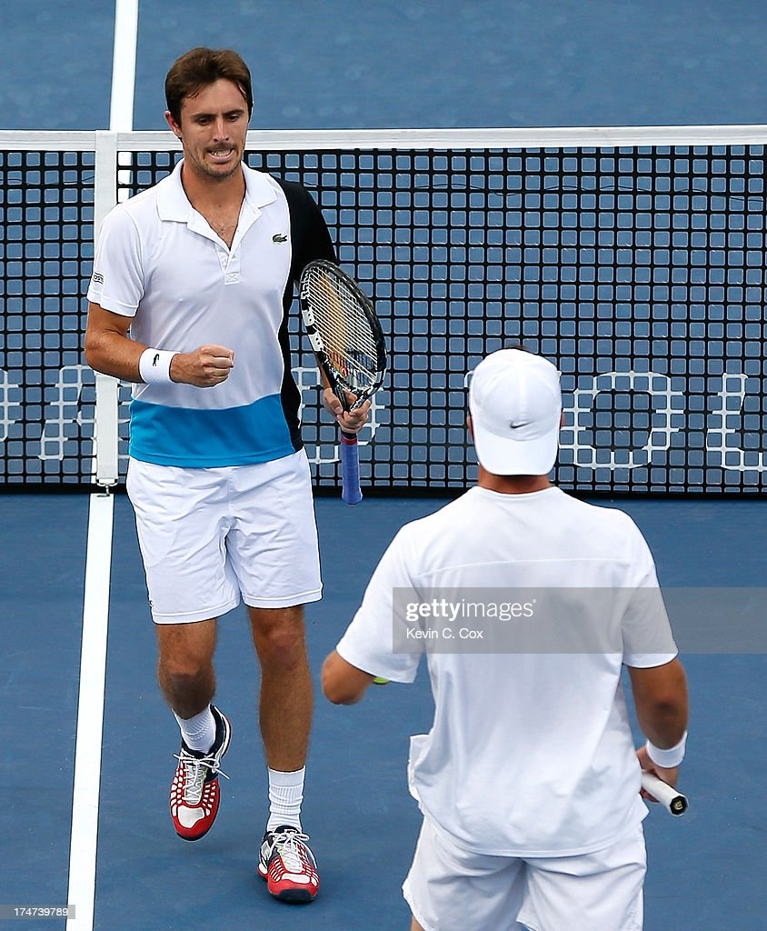 Igor Sijsling of the Netherlands and Edouard Roger-Vasselin of France react after winning a point against Colin Fleming and Jonathan Marray, both of Great Britain during the BB&T Atlanta Open in Atlantic Station on July 28, 2013 in Atlanta, Georgia.
