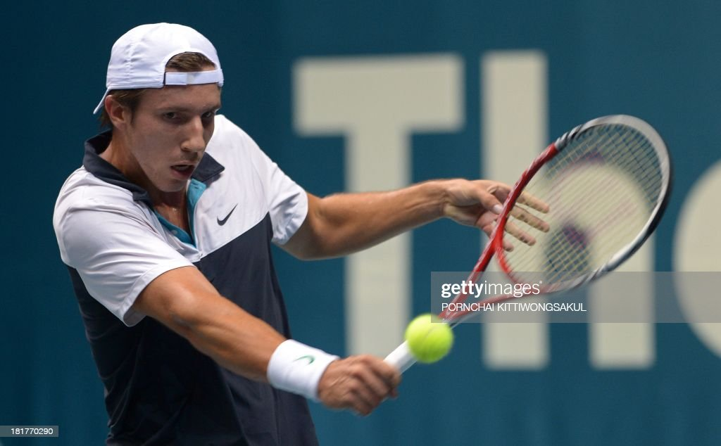 Igor Sijsling of the Netherlands hits the ball as return to his compatriot Robin Hasse during the second round of Tennis ATP Thailand Open 2013 tournament in Bangkok on September 25, 2013. AFP PHOTO / PORNCHAI KITTIWONGSAKUL