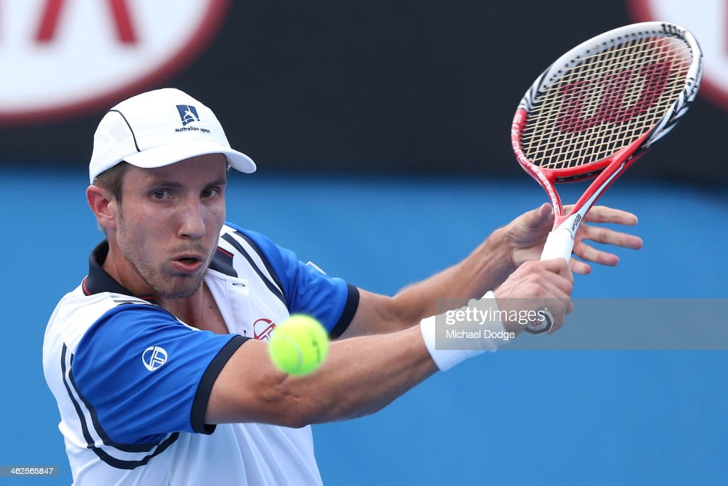 Igor Sijsling of the Netherlands plays a backhand in his first round match against Thanasi Kokkinakis of Australia during day two of the 2014 Australian Open at Melbourne Park on January 14, 2014 in Melbourne, Australia.