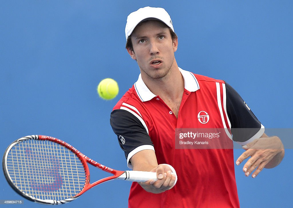 <a gi-track='captionPersonalityLinkClicked' href=/galleries/search?phrase=Igor+Sijsling&family=editorial&specificpeople=878881 ng-click='$event.stopPropagation()'>Igor Sijsling</a> of the Netherlands plays a backhand in his match partnered with Denis Istomin of Uzbekistan in their match against Mariusz Fyrstenberg of Poland and Daniel Nestor of Canadaduring day four of the 2014 Brisbane International at Queensland Tennis Centre on January 1, 2014 in Brisbane, Australia.