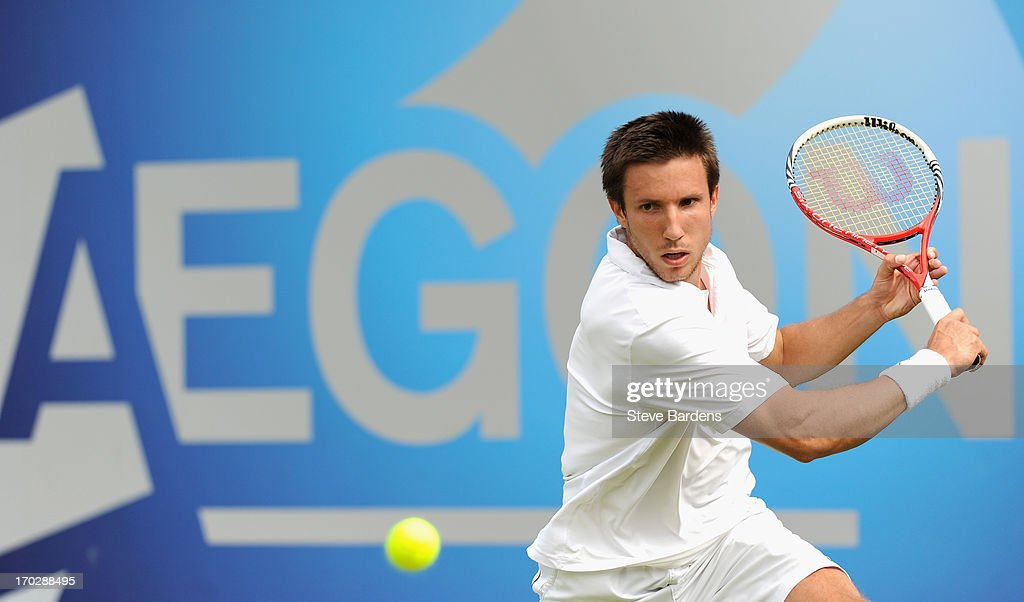 <a gi-track='captionPersonalityLinkClicked' href=/galleries/search?phrase=Igor+Sijsling&family=editorial&specificpeople=878881 ng-click='$event.stopPropagation()'>Igor Sijsling</a> of the Netherlands plays a backhand shot during his Men's Singles first round match against Tatsuma Ito of Japan on day one of the AEGON Championships at Queens Club on June 10, 2013 in London, England.