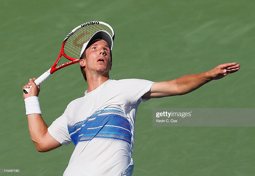 Igor Sijsling of the Netherlands serves to Ryan Harrison during the BB&T Atlanta Open in Atlantic Station on July 25, 2013 in Atlanta, Georgia.