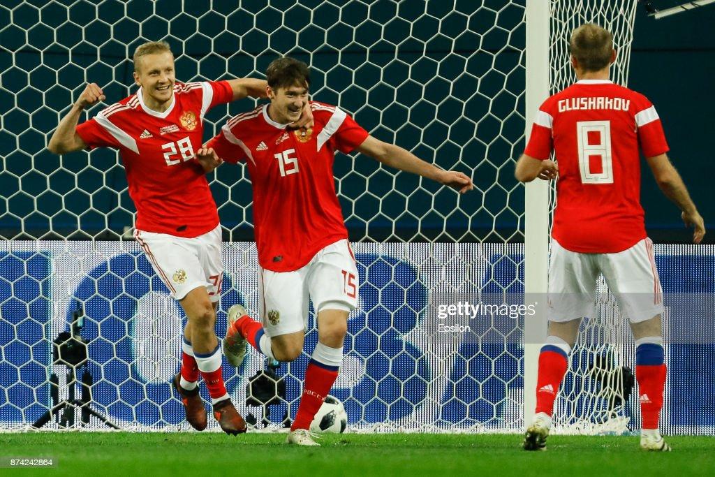 Igor Smolnikov (L), Aleksei Miranchuk (C) and Denis Glushakov of Russia celebrate a goal during Russia and Spain International friendly match on November 14, 2017 at Saint Petersburg Stadium in Saint Petersburg, Russia.