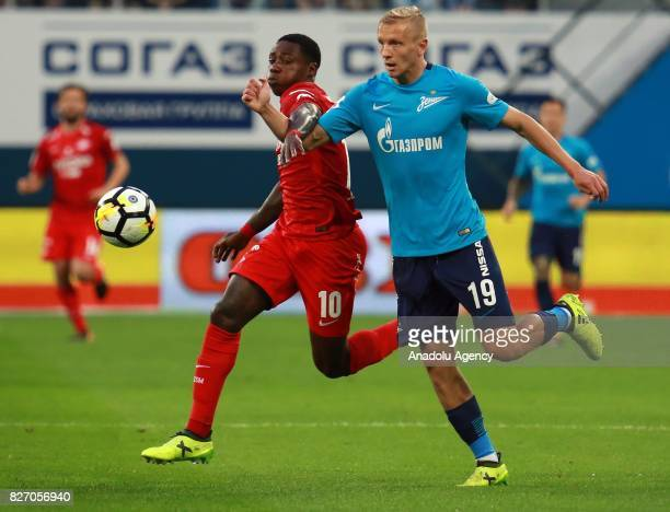 Igor Smolnikov of FC Zenit SaintPetersburg in action against Quincy Promes of FC Spartak Moscow during the Russian Premiere League match between...