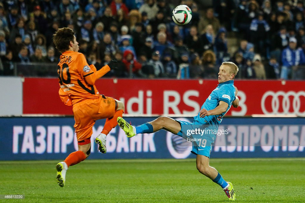 <a gi-track='captionPersonalityLinkClicked' href=/galleries/search?phrase=Igor+Smolnikov&family=editorial&specificpeople=3977853 ng-click='$event.stopPropagation()'>Igor Smolnikov</a> of FC Zenit St. Petersburg (R) and <a gi-track='captionPersonalityLinkClicked' href=/galleries/search?phrase=Fyodor+Smolov&family=editorial&specificpeople=4277688 ng-click='$event.stopPropagation()'>Fyodor Smolov</a> of FC Ural Sverdlovsk Oblast vie for the ball during the Russian Football League match between FC Zenit St. Petersburg and FC Ural Sverdlovsk Oblast at the Petrovsky stadium on March 7, 2015 in St. Petersburg, Russia.