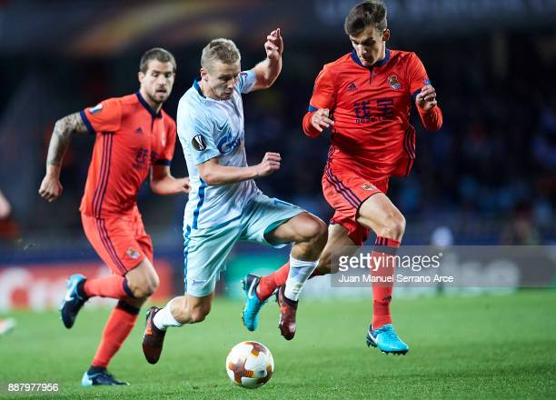 Igor Smolnikov of Zenit St Petersburg duels for the ball with Diego Llorente of Real Sociedad during the UEFA Europa League group L football match...