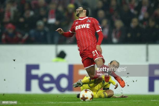 Igor Stasevich of FC Bate Borisov tackles Leonardo Jesus Bittencourt of FC Koeln during the UEFA Europa League group H match between 1 FC Koeln and...