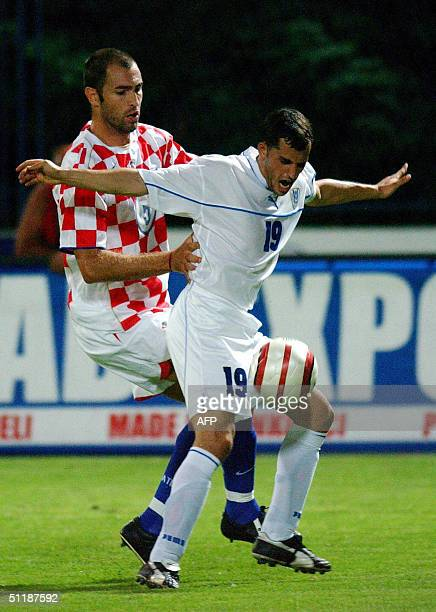 Igor Tudor of Croatia fights for the ball with Ravid Gazal of Israel during their friendly match in Varazdin Croatia 18 August 2004 AFP PHOTO DENIS...