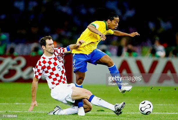 Igor Tudor of Croatia tackles Ronaldinho of Brazil during the FIFA World Cup Germany 2006 Group F match between Brazil and Croatia played at the...
