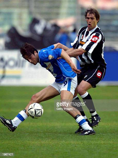 Igor Tudor of Juventus and Luca Toni of Brescia in action during the Serie A match between Juventus and Brescia played at the Stadio Delle Alpi Turin...