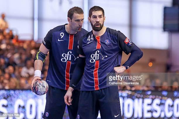 Igor Vori and Nikola Karabatic of Paris Saint Germain are talking about a system during the quarter final EHF Champions League game between Paris...