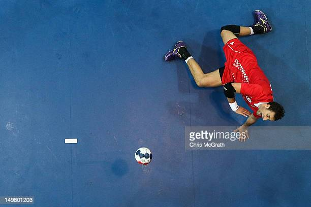 Igor Vori of Croatia dives to take a shot at goal during the Men's Handball Preliminaries Group B match between Croatia and Denmark on Day 8 of the...