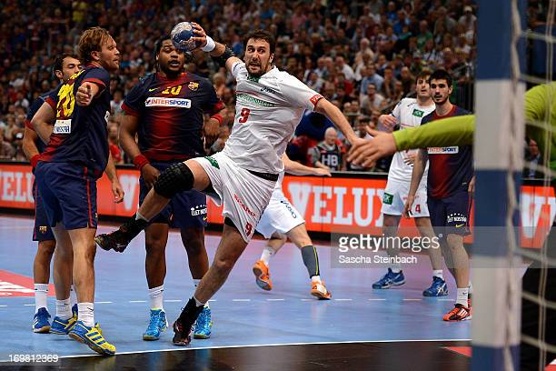 Igor Vori of Hamburg throws the ball during the EHF Final Four final match between FC Barcelona Intersport and HSV Hamburg at Lanxess Arena on June 2...
