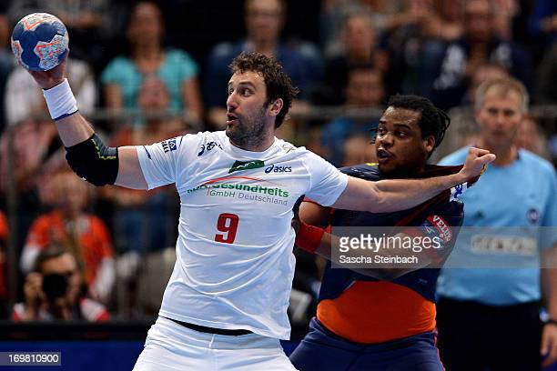 Igor Vori of Hamburg vies with Cedric Sorhaindo of Barcelona during the EHF Final Four final match between FC Barcelona Intersport and HSV Hamburg at...