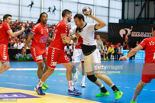 Igor Vori of Paris Handball is trying to shoot the ball against Pierre Paturel of Chambery Savoie Handball during the men final game of the French...