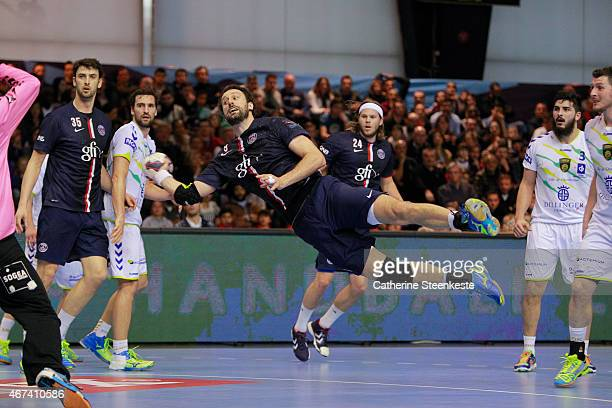 Igor Vori of PSG Handball is shooting the ball against William Annotel of Dunkerque HB Grand Littoral during the last 16 VELUX EHF Champions League...