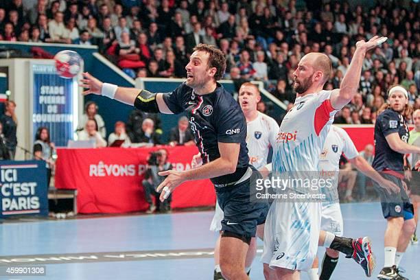 Igor Vori of PSG Handball shoots the ball against Vid Kavticnik of Montpellier Agglomeration Handball during the game between PSG Handball and MAHB...