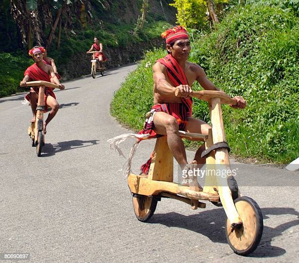 Igorot tribesmen race their wooden scooters in the northern mountainous town of Banaue during a competition on April 16 2008 as the town celebrates...