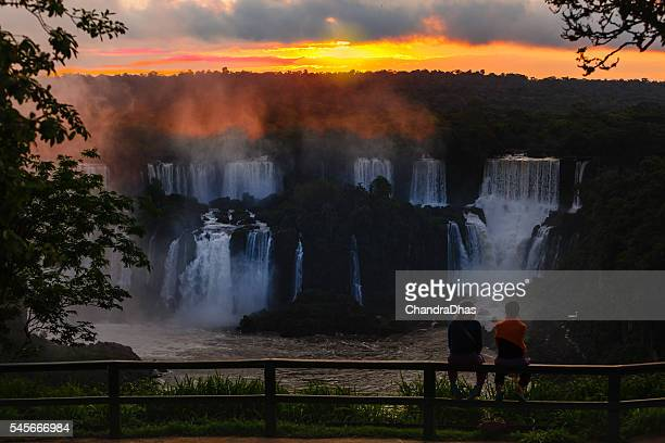 Iguacu, Brazil - tourists watch sunset over the falls