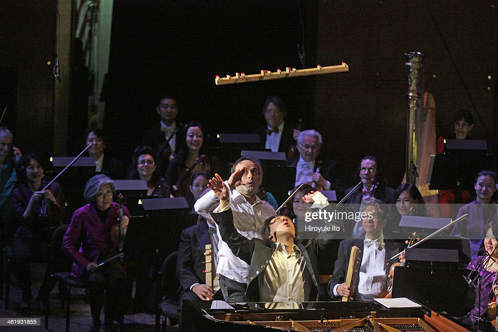 Igudesman Joo performing with the New York Philharmonic led by Alan Gilbert at Avery Fisher Hall on Tuesday night December 31 2013This imageAleksey...