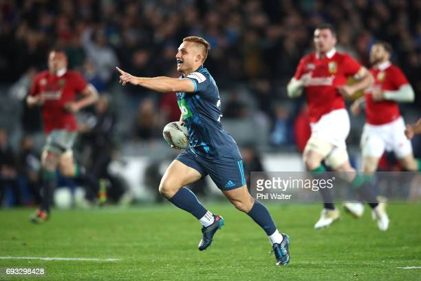 Ihaia West of the Blues celebrates as he runs in to score a try during the match between the Auckland Blues and the British Irish Lions at Eden Park...