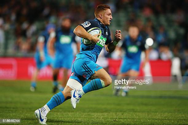 Ihaia West of the Blues makes a break to score a try during the round 6 super rugby match between the Blues and the Jaguares at QBE Stadium on April...