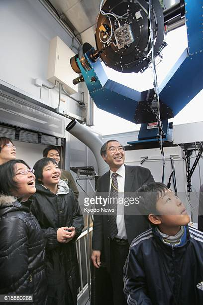 Ihara Japan Noritsugu Takahashi board chairman of the Japan Spaceguard Association explains to children about the organization's work and telescope...