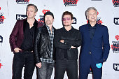 iHeartMedia's President of National Programming Platforms Tom Poleman recording artists The Edge and Bono and iHeartMedia's President of...