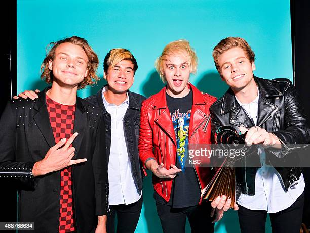 Ashton Irwin Luke Hemmings Michael Clifford and Calum Hood of 5 Seconds of Summer pose in the NBC photo booth during the 2015 iHeartRadio Music...