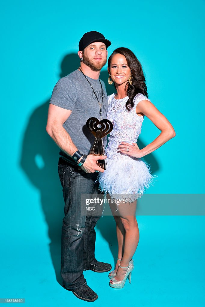 Recording artist Brantley Gilbert and wife Amber Cochran pose in the NBC photo booth during the 2015 iHeartRadio Music Awards held at the Shrine Auditorium on March 29, 2015 in Los Angeles, California.--