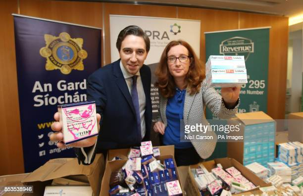 iHeath Minister Simon Harris and Dr Lorraine Nolan chief executive of the Health Products Regulatory Authority pose with illigal medicines seized as...