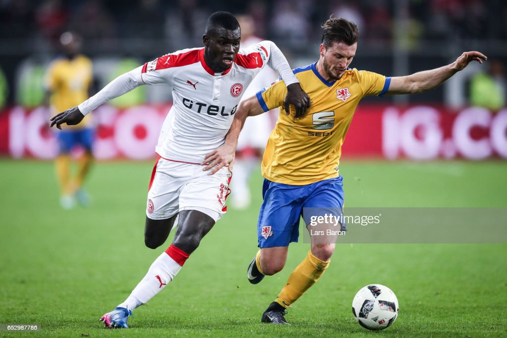 Ihlas Bebou of Duesseldorf (L) and Quirin Moll of Braunschweig battle for the ball during the Second Bundesliga match between Fortuna Duesseldorf and Eintracht Braunschweig at Esprit-Arena on March 13, 2017 in Duesseldorf, Germany.