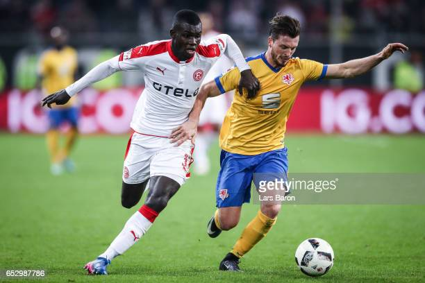 Ihlas Bebou of Duesseldorf and Quirin Moll of Braunschweig battle for the ball during the Second Bundesliga match between Fortuna Duesseldorf and...